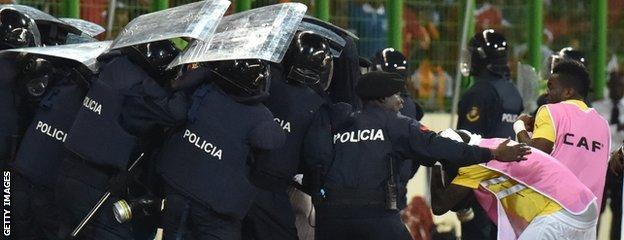 Police shielded Ghana players from objects being thrown from the stands
