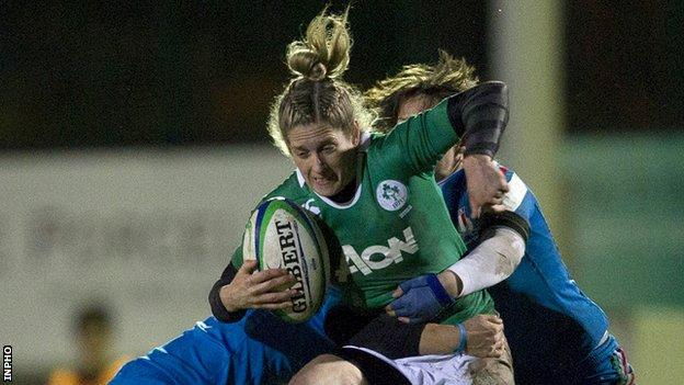 Alison Miller is held up by a couple of Italian tacklers