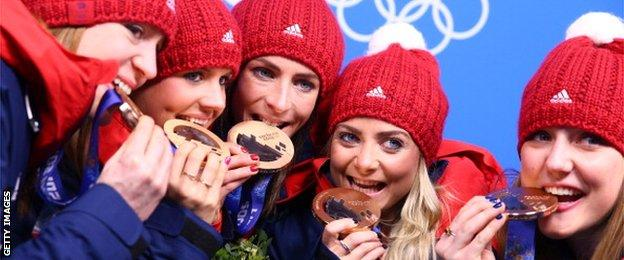 Claire Hamilton, Vicki Adams, Eve Muirhead, Anna Sloan, and Lauren Gray of Great Britain celebrate during the medal ceremony for Women's Curling