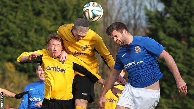 Dan McMurray and Ryan Deans in aerial action with Glenavon's Simon Kelly
