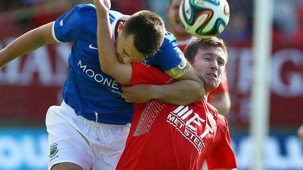 Linfield and Portadown will meet in the pick of the last-eight matches