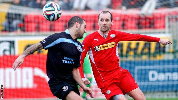 Neal Gawley and Ronan Scannell in action during a frenetic Irish Cup game at Solitude