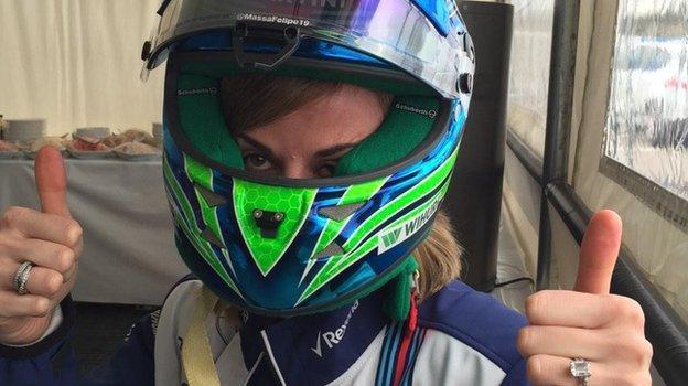 Susie Wolff tries on Felipe Massa's helmet