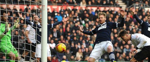 Derby's Jeff Hendrick (far r) scores his second goal against Bolton Wanderers