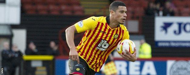 Lyle Taylor celebrates after scoring for Partick Thistle