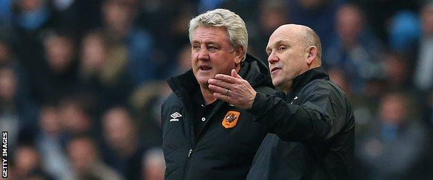 Hull boss Steve Bruce (left) was joined by new assistant manager Mike Phelan in the dug-out at Man City for the first time