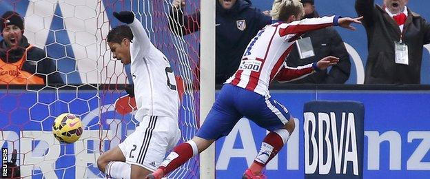 Antoine Griezmann scores the third goal for Atletico Madrid