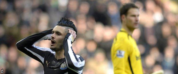 Newcastle playmaker Remy Cabella (left) reacts after Stoke keeper Asmir Begovic saves a header from him