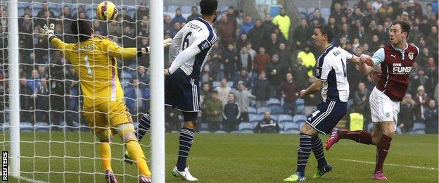 Ashley Barnes (left) heads in the opening goal for Burnley