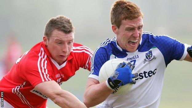 Brian Hurley of Cork challenges Monaghan's Kieran Duffy