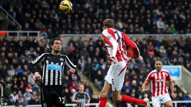 Stoke striker Peter Crouch scores his side's equaliser at Newcastle