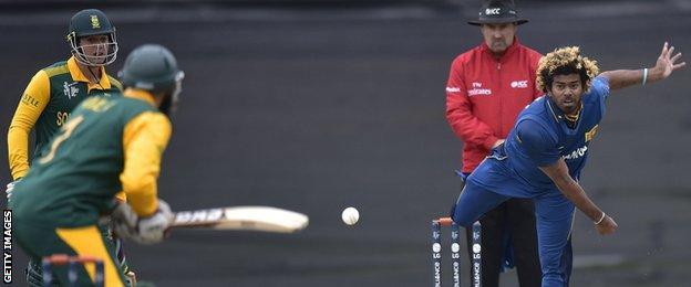 Sri Lanka's Lasith Malinga bowls to South Africa's Hashim Amla