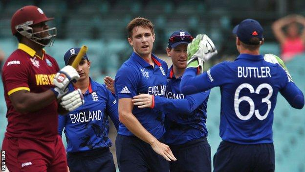 England celebrate after Chris Woakes (centre) dismisses West Indies' Dwayne Smith