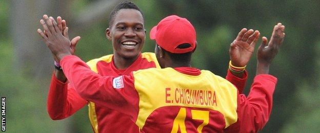 Zimbabwe's Tafadzwa Kamungozi and Elton Chigumbura celebrate a wicket against New Zealand