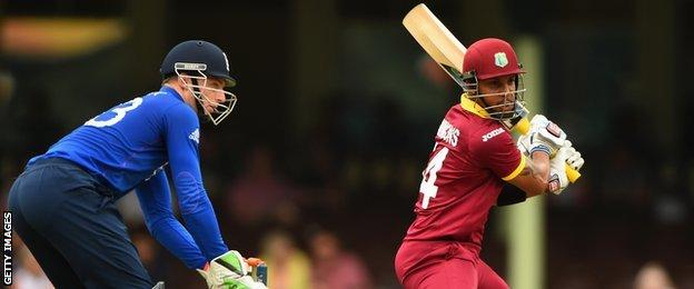 West Indies' Lendl Simmons hits out, watched by England keeper Jos Buttler