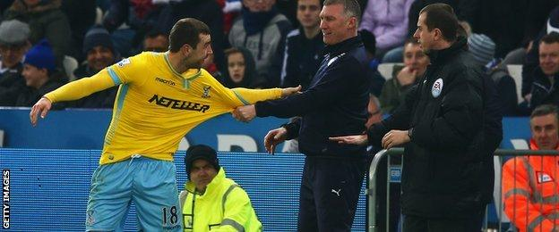 Pearson grabs McArthur's shirt after their touchline tangle