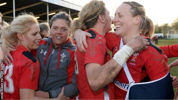 Rachel Taylor and Rebecca Lowe hug after Wales' win over England