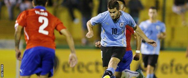 Uruguay's Gaston Pereiro scores against Chile during the South American under-20 Championship