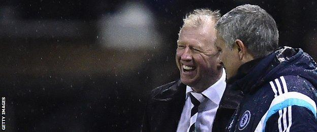 Steve McClaren (left) and Chelsea manager Jose Mourinho discuss the action during the Capital One Cup tie between the sides in December 2014