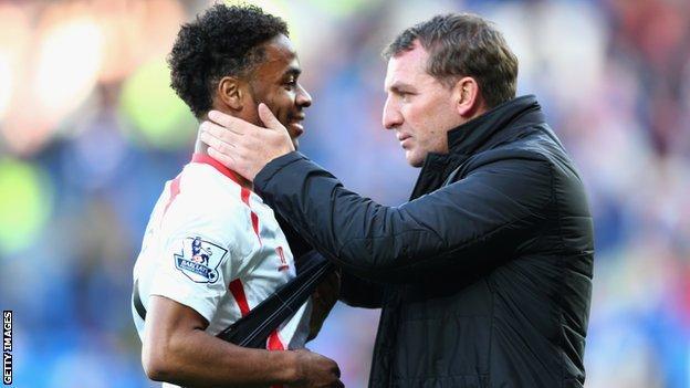 Brendan Rodgers (right) embraces Raheem Sterling