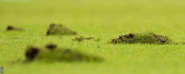 Hampden Park's pitch cut up badly