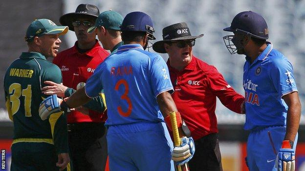 Umpires intervene as Australia's David Warner (left) confronts India's Rohit Sharma (right)
