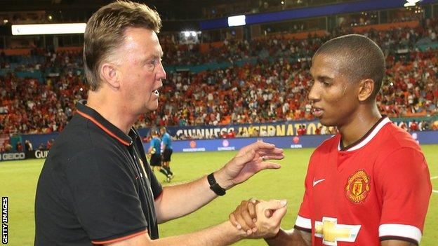 Manchester United manager Louis Van Gaal (left) and winger Ashley Young