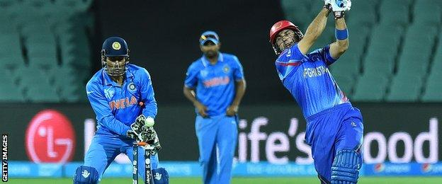Afghanistan captain Mohammad Nabi is bowled
