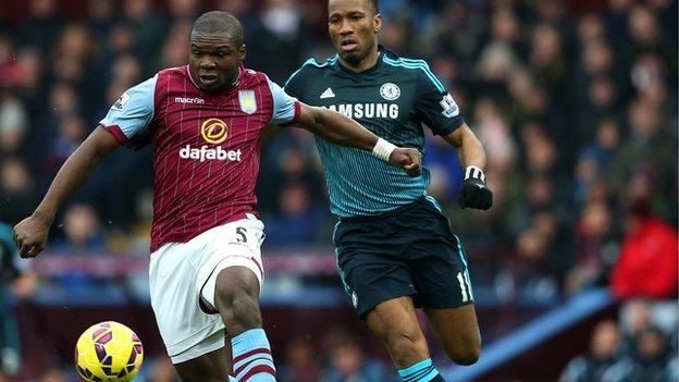 Jores Okore (left)