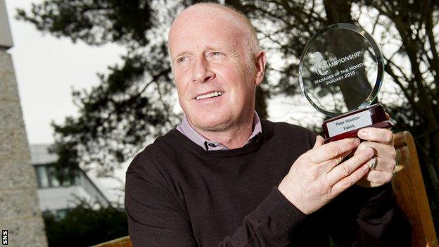 Falkirk manager Peter Houston with his manager of the month award