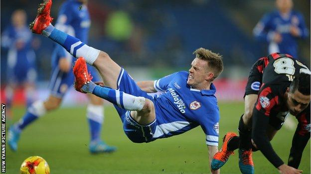 Cardiff City's Craig Noone is brought down by Brighton's Beram Kayal