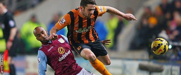 Robbie Brady is tackled by Fabian Delph