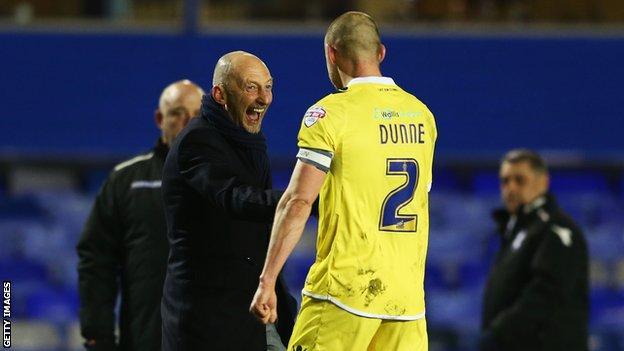 Alan Dunne (right) celebrates with Ian Holloway