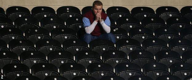 An Aston Villa fan at Hull's KC Stadium