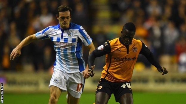 Wolves striker Nouha Dicko in action against Jack Robinson of Huddersfield