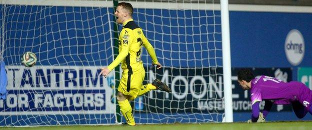 Martin Murray runs away in celebration after scoring the equaliser against Linfield