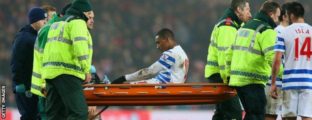 Leroy Fer is stretchered off