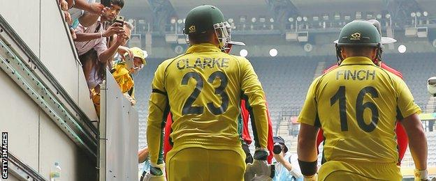 Michael Clarke and Aaron Finch walk out to open the innings