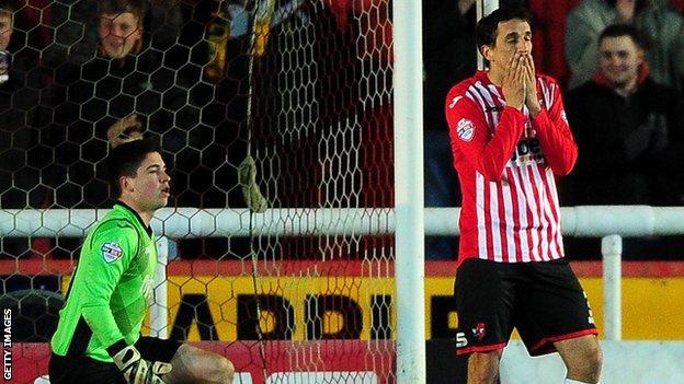 Craig Woodman reacts after scoring an own goal against Cambridge