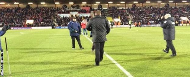 Scott Mitchell walks out on the pitch at half-time