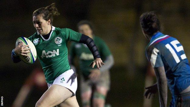 Katie Fitzhenry bursts away from Italian full-back Manuela Furlan in last Friday's game in Florence