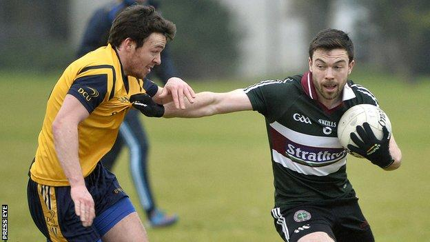 St Mary's Aidan Corker attempts to fend off DCU's Conor Moynagh in Belfast