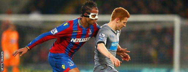 Marouane Chamakh vies for the ball with Jack Colback