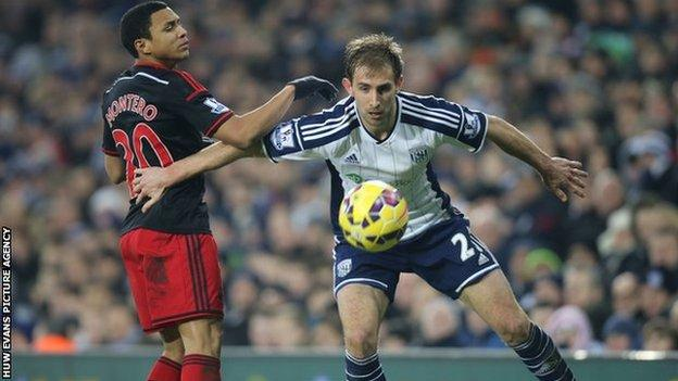 Craig Dawson of West Brom holds off Swansea's Jefferson Montero