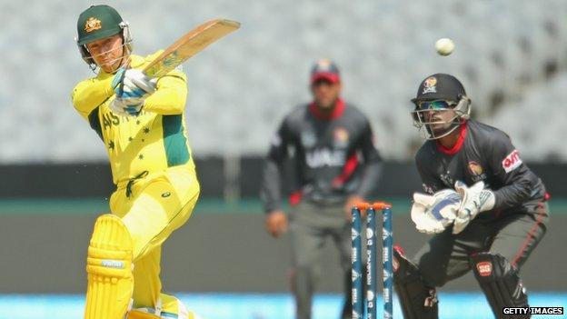 Michael Clarke of Australia hits a boundary against the UAE (11 February 2015)