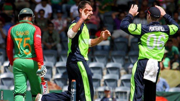 Bangladesh batsman Shakib Al Hasan walks off as Max Sorensen celebrates taking his wicket
