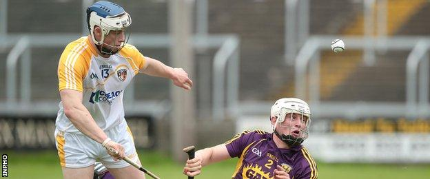 Conor Johnson battles with Wexford's Liam Ryan in last summer's Leinster Championship game