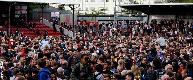 Brentford fans celebrate winning promotion into the Championship during the Sky Bet League One match between Brentford and Preston North End at Griffin Park.
