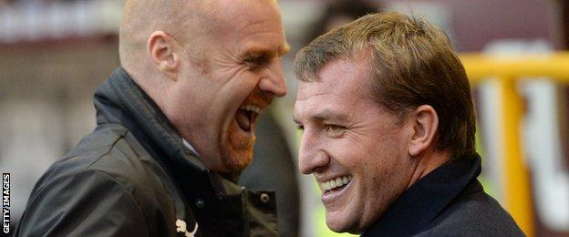 Burnley's manager Sean Dyche and Liverpool's manager Brendan Rodgers share a joke