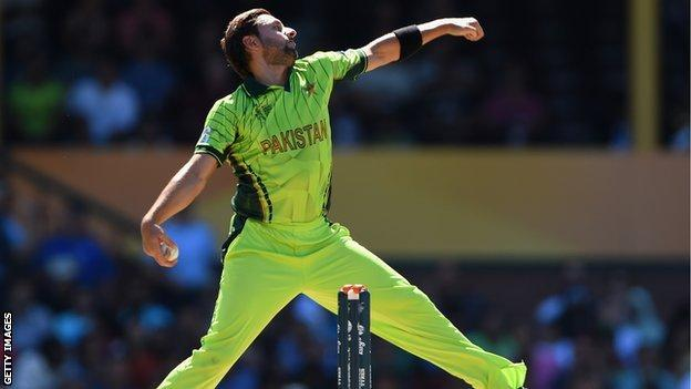Shahid Afridi of Pakistan bowls during the World Cup warm-up match against England